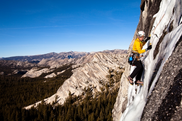 An ice climber climbs Yellow Brick Road on Drug Dome in Tuolumne Meadows located inside Yosemite National Park, California.